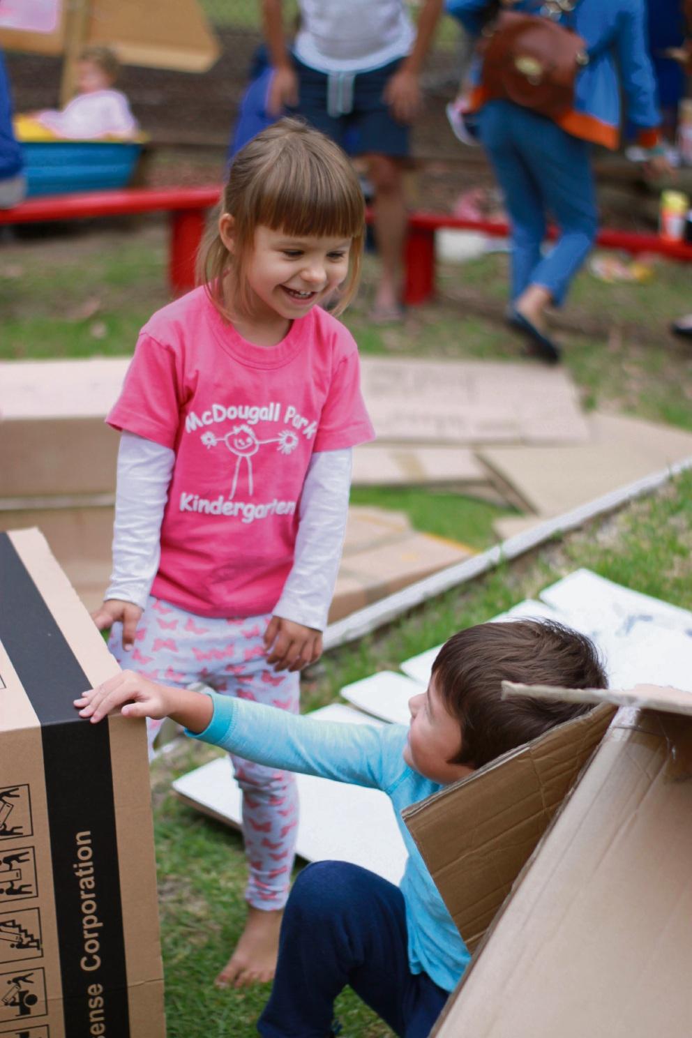 McDougall Park Community Kindergarten Students Carla Czech and Isaac Court enjoy Cardboard City.