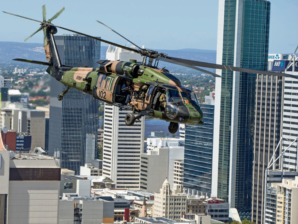 A Blackhawk army helicopter flies over Perth during emergency response exercises. Picture courtesy: Steve Ferrier/The West Australian