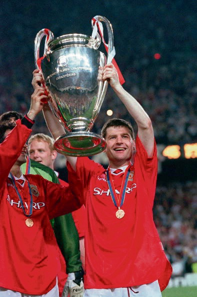 Denis Irwin lifts the Champions League trophy. Picture: Popperfoto/Getty Images