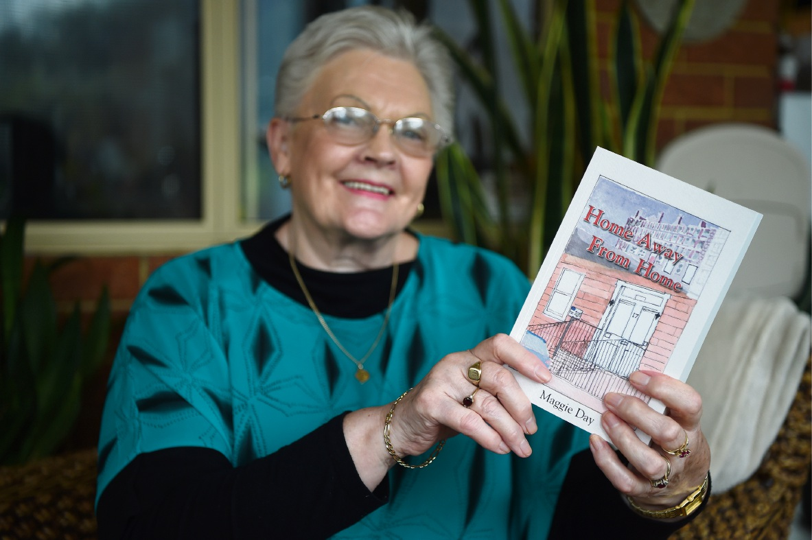 Comedy, crime and a little bit of sauciness: Margaret Day with her book. Picture: Jon Hewson