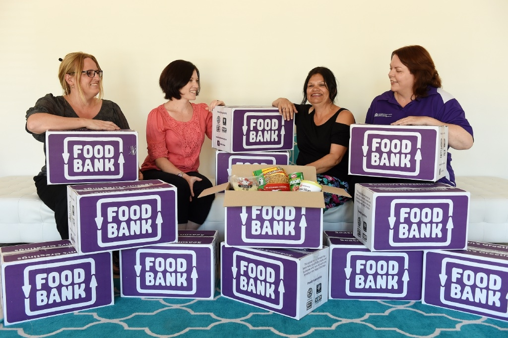 Salome Candy, Lizzi4e Fairall, Fiona Cox and Ruth Aspinall with food hampers. Picture: Jon Hewson.  d447901.