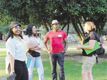 Virgina Chivays, Caroline Muchineripi and Irvine Dahwa talk to Yanchep Park guide Madonna Mulholland.