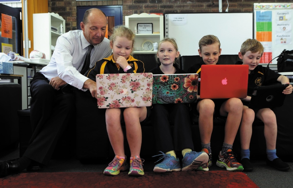 Associate principal Andrew Etheridge with Amy Stephens (Year4), Ella Buswell (Year 4), Callum Stephens (Year 6) and Louis Buswell (Year 2) . Picture: Martin Kennealey        www.communitypix.com.au   d438736