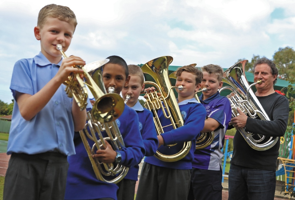 Students Charlie Henderson and William Bennion with euphonium player Riki McDonnell.Picture: Matt Jelonek        www.communitypix.com.au   d438819