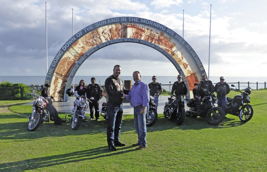 Shane Kempton and Rick Green with members of the Military Brotherhood Military Motorcycle Club.
