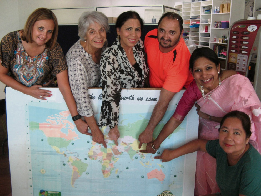 Organisers Wendy King, Angela Simms, Mehrangiz Kalani, Chris Faure, Dilshad Rahman and Virginia Pitts point to their places of origin on the map.