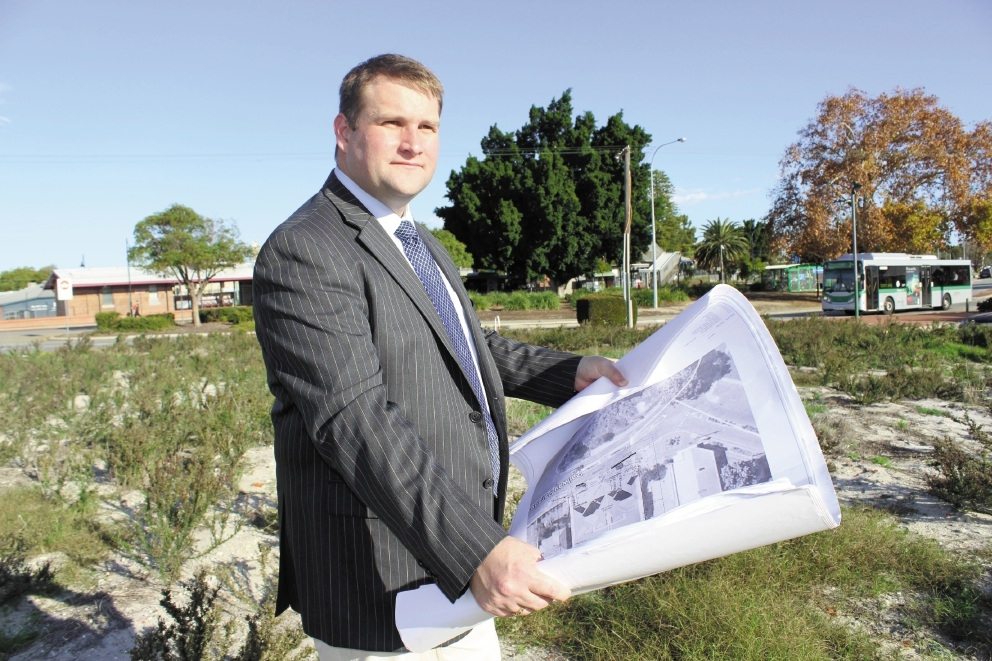 Bassendean Mayor John Gangell with the plans for a 22-unit |development on Railway Parade.