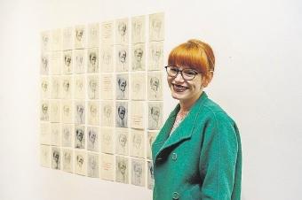 Rebecca Jensen with her artwork.