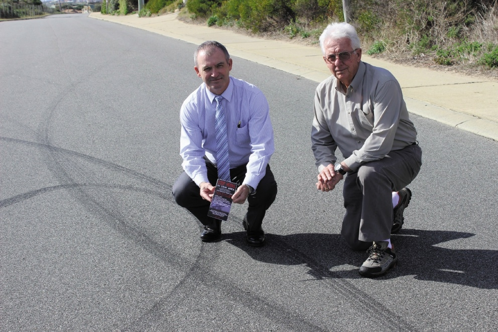 Dr Kim Hames and Charlie Gibson with evidence of hoon driving in Falcon.
