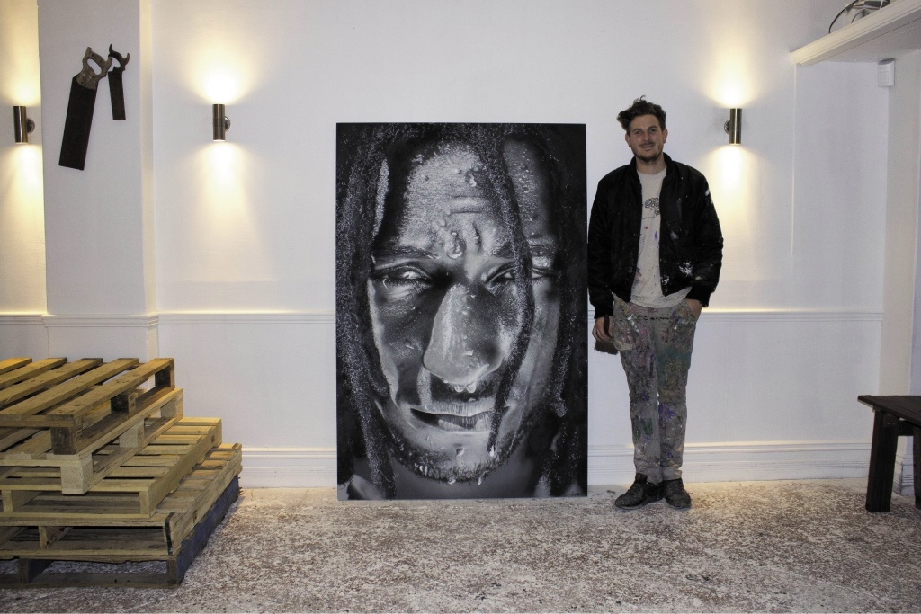 Jerome Davenport with his portrait of AFL star Nic Naitanui.        Picture: Aston Van Eldik