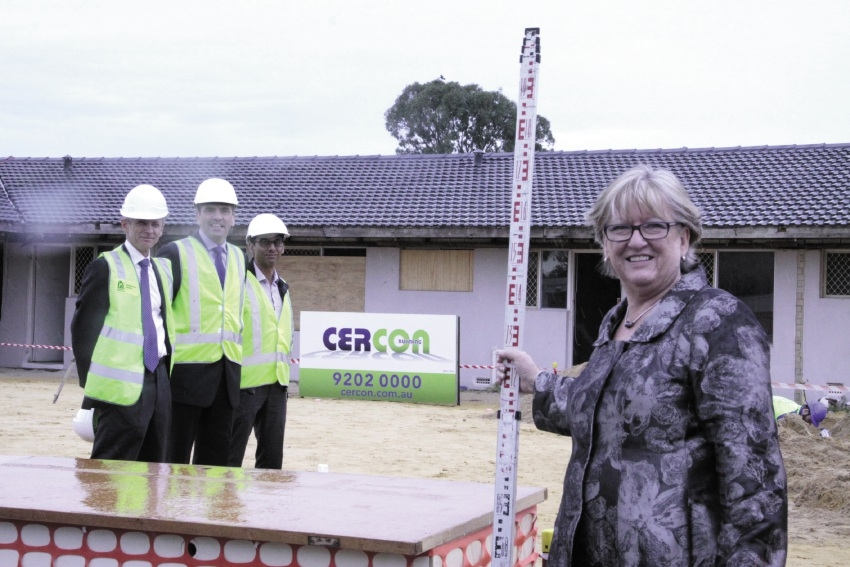Mental Health Minister Helen Morton inspects the new facility with Housing Department representatives Matthew Meyers, David Carpenter and Simon Bell.