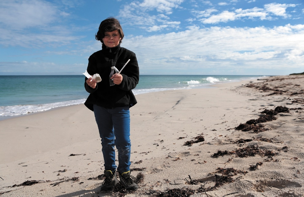 Alex Wake (9) with plastic he found on the beach. Picture: Martin Kennealey  d439586