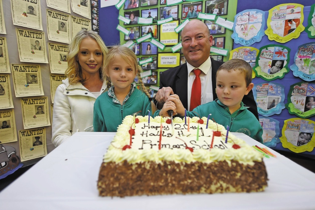 Former Halls Head Primary School student Lauren Holt with Jayla, principal Peter Beckingham and Jacob Towie. Picture: Jon Hewson        www.communitypix.com.au   d437960