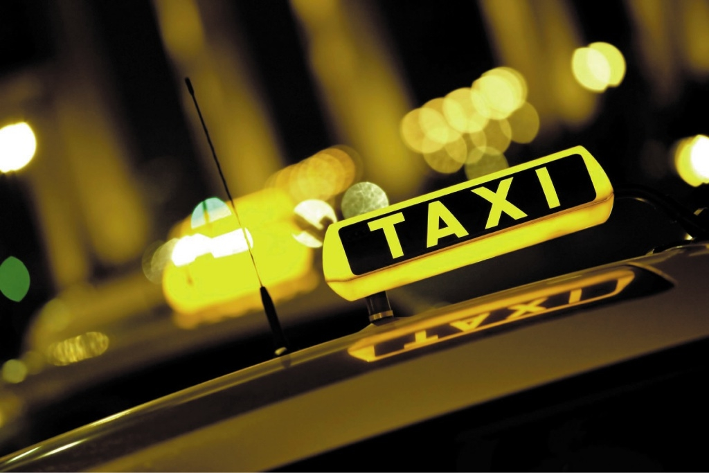 A woman has been charged for allegedly holding a knife to a cab driver.
