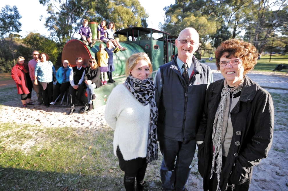 Mundaring Shire councillor Bob Perks, Glen Forrest Rate Payers Association vice-president Rebecca Buswell and Mundaring Shire President Helen Dullard  with some local children at the new playground. Picture: David Baylis          d439691