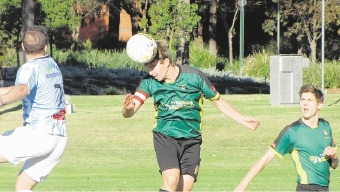Curtin captain Kye Middleton wins a header on Saturday.