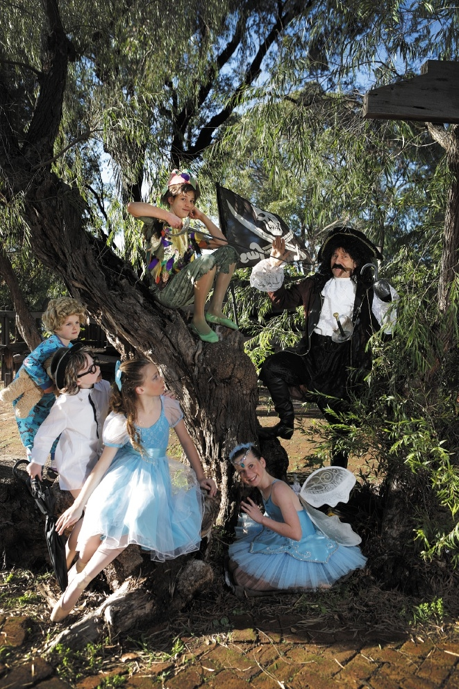 L-R Katie Daly (Michael), Madison Hale (John), Charlotte Fenn (Wendy), Isobel Finnie (Peter Pan), Scarlett O'Grady (Tinkerbell) and Igor Sas as Captain Hook. Picture:  Andrew Ritchie d439696