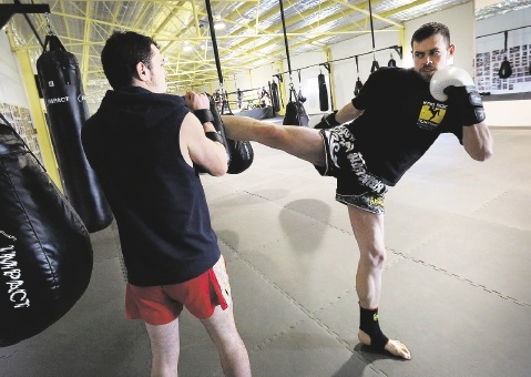 Gordon Young has overcome many obstacles to return to muay thai, working out with |trainer Sam Ballantyne. Picture: Matt Jelonek        www.communitypix.com.au   d441150Gordon took inspiration from the stories of how others had overcome tough times.