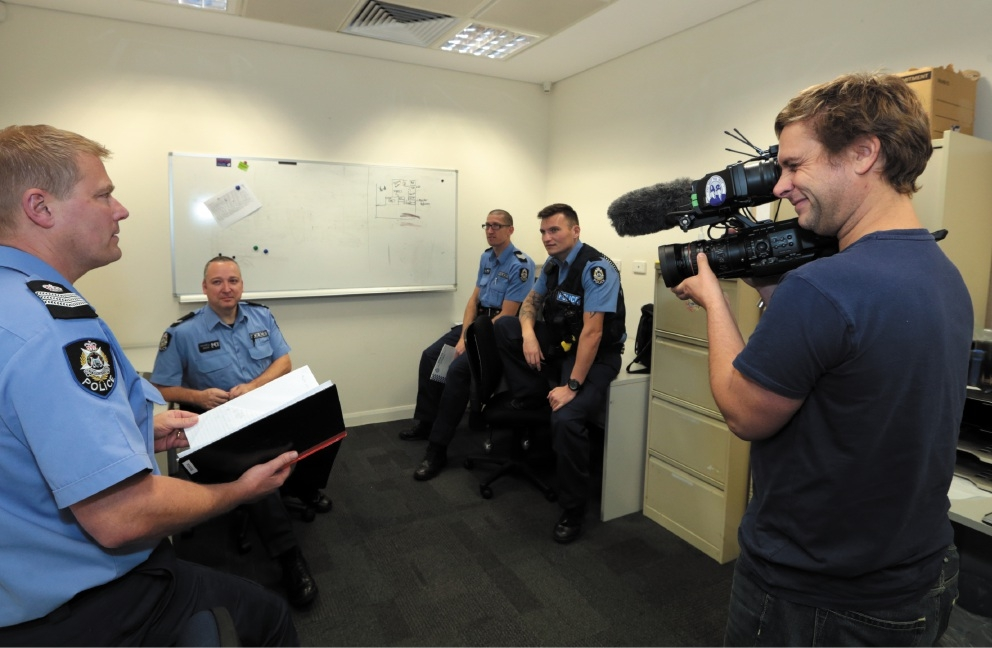 Cameraman Philip Mulroy taping acting Senior Sergeant Darren Lumb, First Class Constable Paul Faithful, Senior Constable Rob Rixson and Constable Colin Todd for the documentary Emergency Services Downunder.  Picture: Martin Kennealey        d441921