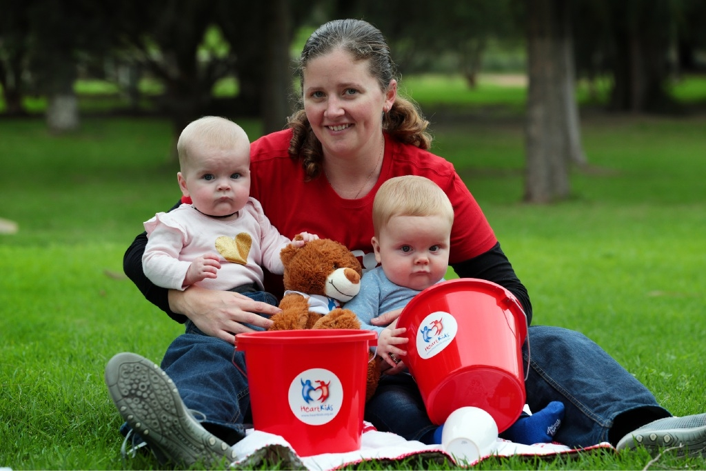 Kelly Monro with twins Emily and Jack. After the surgery, Emily is like any other baby.Picture: Martin Kennealey        www.communitypix.com.au   d442181