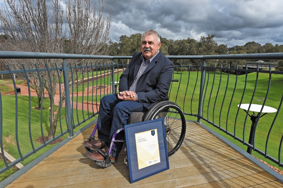 Councillor Wayne Barrett with his Long and Loyal Service Award. Picture: Jon Hewson d442282