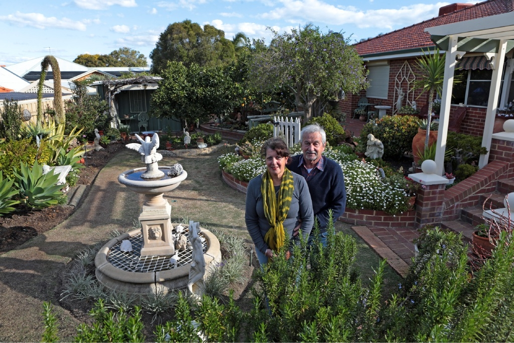 Aurora and James Stergiou, who has Alzheimer's Disease, in their Woodvale garden, which they are opening to raise funds . Picture: Martin Kennealey        www.communitypix.com.au   d442734
