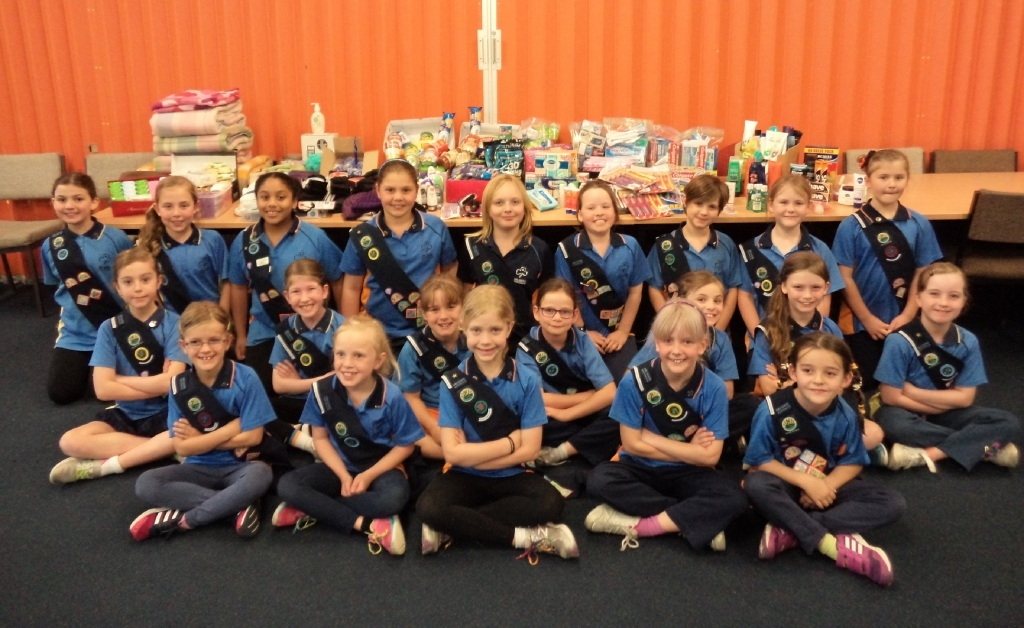 Edgewater Sunshine Girl Guides members with their donated items.