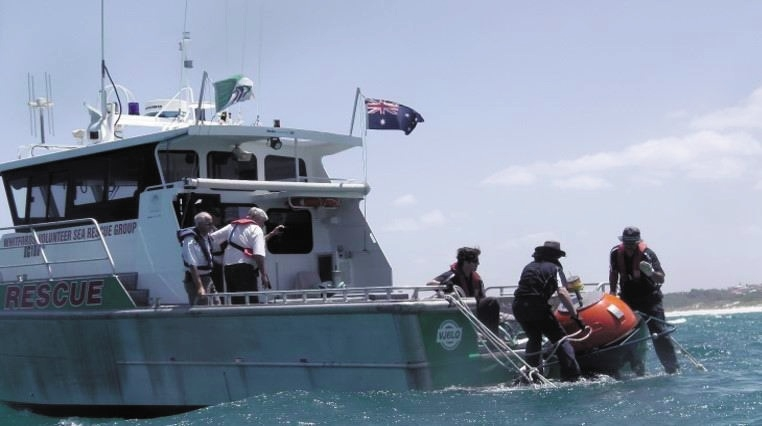 Whitfords Volunteer Sea Rescue helps Mullaloo Surf Life Saving Club to deploy a shark detection buoy.