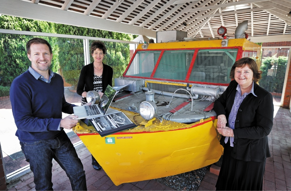 Author Gordon Bass with Ben Carlin's daughter Deirdre and Guildford Grammar archivist Rosemary Waller and Half Safe, the amphibious vehicle used by Carlin in his circumnavigation of the world. Picture: David Baylis           d443079
