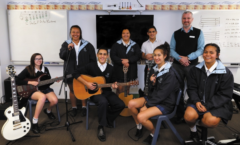 Music director Paul Johnson with music students. Picture: Martin Kennealey          d443066