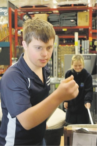 Kye helps out at Bunnings with Jess in the background.