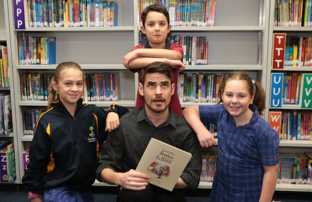 Joel Blakeley, who illustrated Little Miss Jessica Goes To School, with Year 4 students  Maddie Loft, Adam Kempster and Hannah Williams. Picture: Martin Kennealey d442992