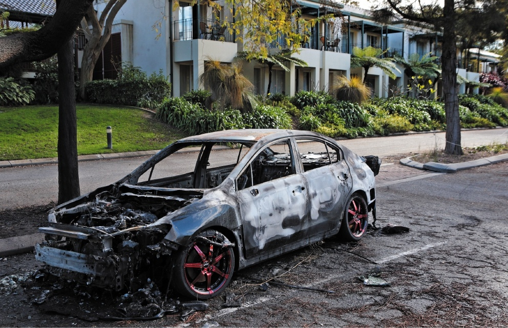 The burnt-out car.  Picture: Martin Kennealey d442909