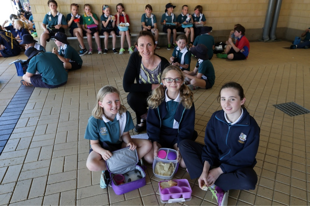 Two Rocks Primary teacher Samantha Wright with Year 5 students Shayla Howse, Charlee Jory and Laela Mitchell.            d443984
