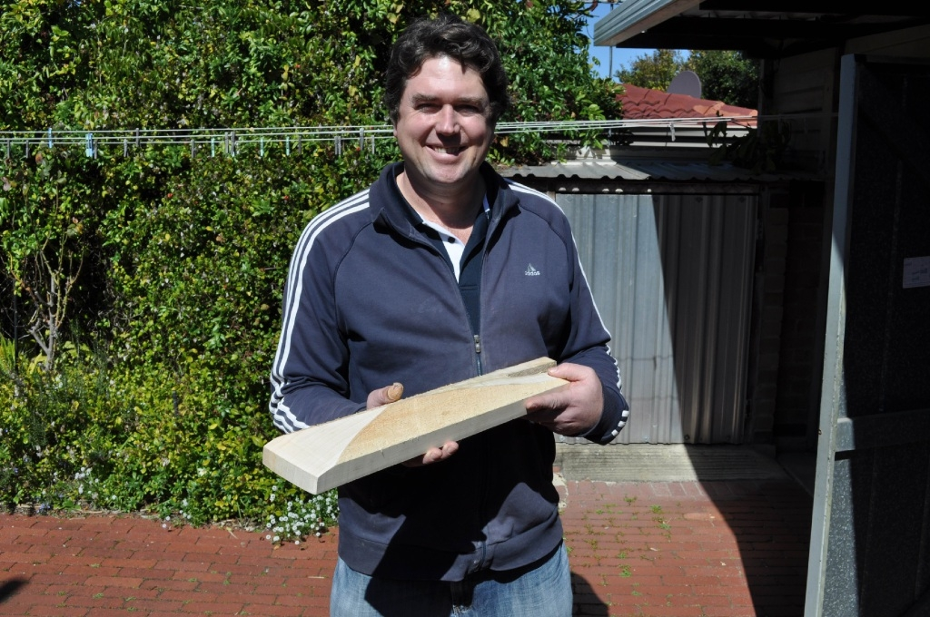 Toby Richardson at work on the edges of a new bat.