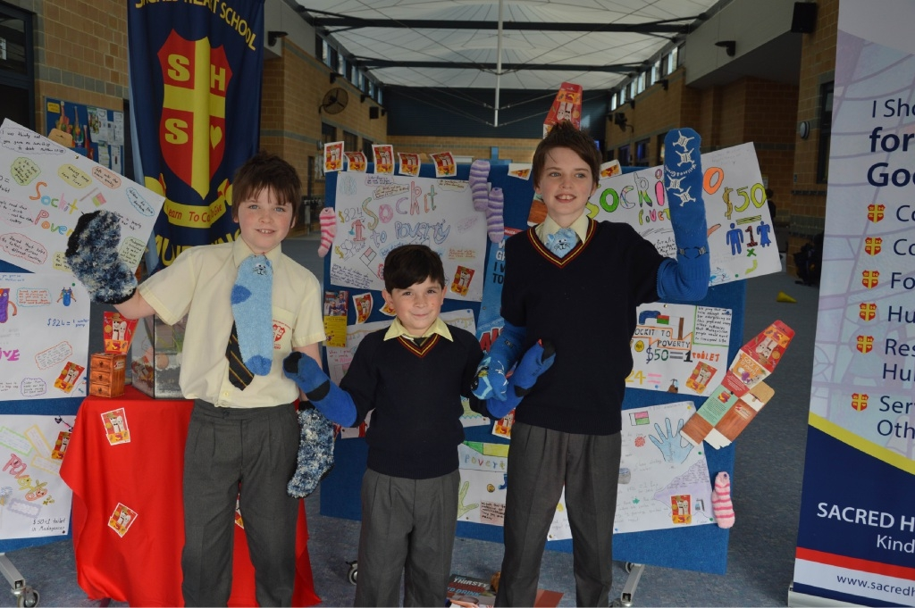 Sacred Heart Primary School students Gerodie Mattner, Angus Parker and Sebastian Mattner sock it for charity.