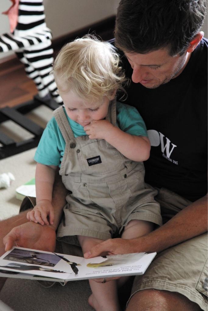 Brad Smith reading to toddler son Oliver at Ngala's Dad WA program.