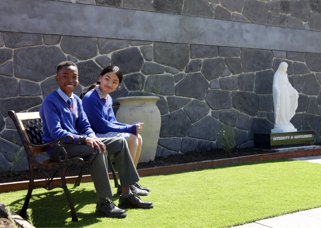 Ishmail Falama and Haylee Nguyen in the school garden. Picture: Martin Kennealey               d443500