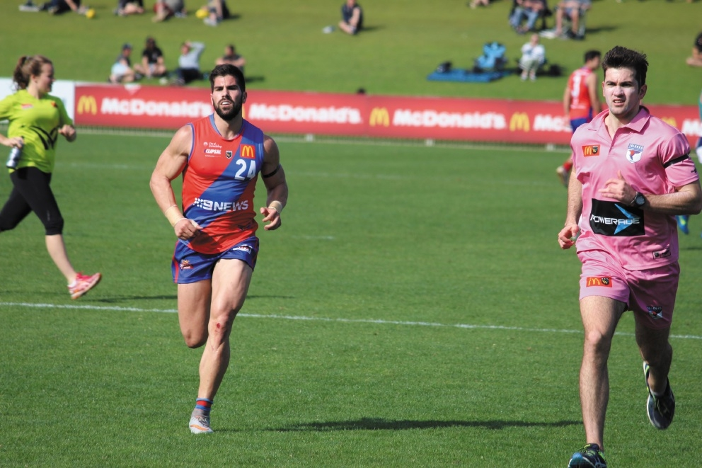 Luke Adams brings his brother off the ground for a spell in the West Perth-Peel Thunder qualifying final at Arena Joondalup on Sunday. Picture: J Bianchini