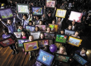Children show off the colourful artwork that will feature in See Me.