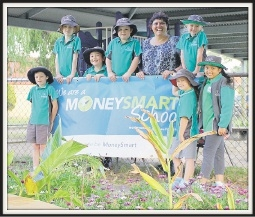Sheila Griffin with Singleton Primary School students celebrate their win.