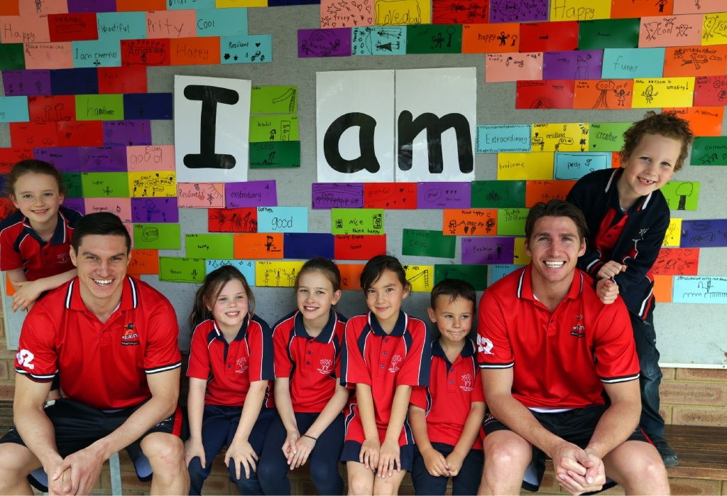 Perth Wildcats players Jarrod Kenny and Damian Martin with students Layla Croot, Bronte McLennan, Holly Berlandier, Elisha Hunt, Lucas Hutton and Jack Schell. Picture: Martin Kennealey www.communitypix.com.au   d443238