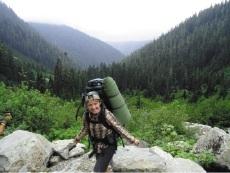 Michaela Gosby trekking through Olympic National Park.