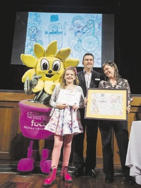 Daisy Chalklen receives her prize during National Children's Book Week.