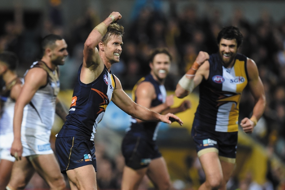 West Coast Eagles forward Josh Kennedy looks on as Mark LeCras celebrates during Friday night's AFL finals win over Hawthorn. Picture: Jon Hewson d443699