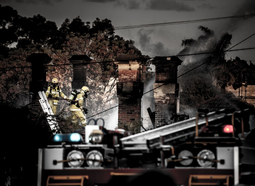 Fire fighters examine the ruins of a West Perth house destroyed by fire on the weekend. Picture: Josh Tucker.