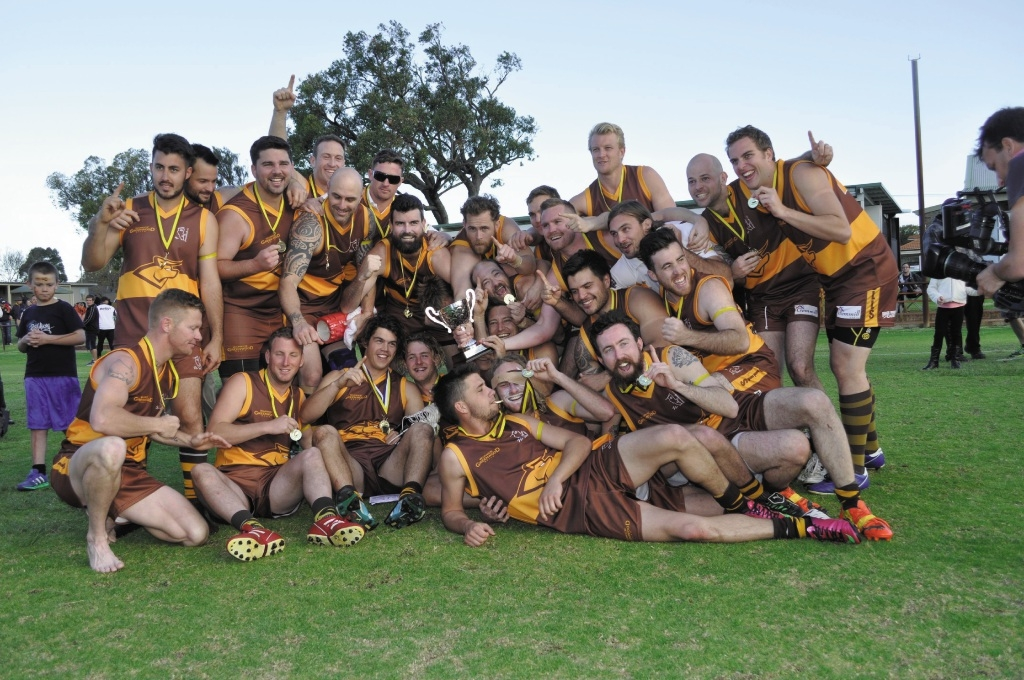 Warwick Greenwood A celebrates winning its first Metro Football League division one premiership. Picture: Tyler Brown