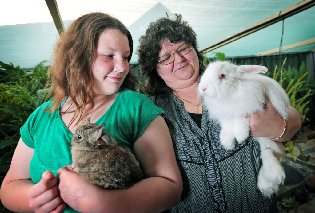 Rebecca Glesson with netherland dwarf rabbit Margaret and her mum Jacqui with swiss fox Memphis.Picture: David Baylis www.communitypix.com.au d443744