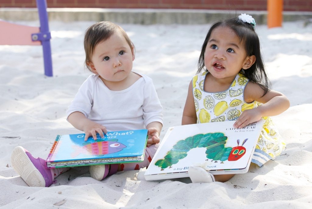 Poppy States (1) and Coleen Agustin (11 months old) with their new books. Picture: Marie Nirme        www.communitypix.com.au   d443385