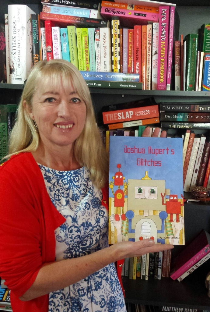 Susan Carameli with her newly published book Joshua Rupert's Glitches.